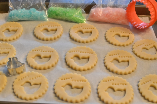 Preparing cookies with cookie cutters and alphabet stamps, then add crushed hard candies after